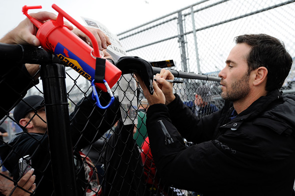 DAYTONA BEACH, FL - JANUARY 09:  Jimmie Johnson, driver of the #48 Lowe's Chevrolet, signs autographs for fans during NASCAR Preseason Thunder at Daytona International Speedway on January 9, 2014 in Daytona Beach, Florida.  (Photo by Jared C. Tilton/NASCAR via Getty Images)