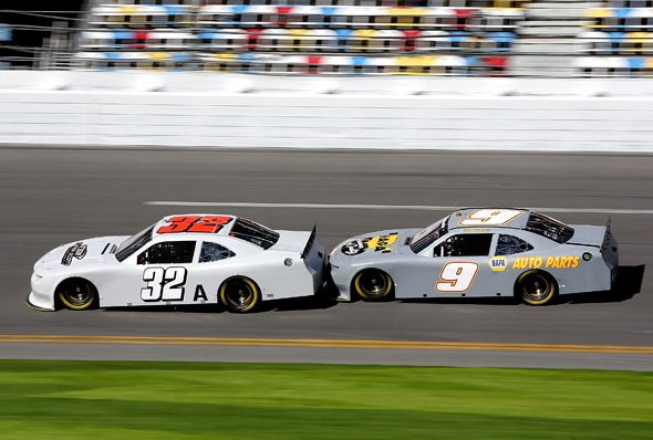 DAYTONA BEACH, FL - JANUARY 12:  Kyle Larson, driver of the #32 Turner Scott Motorsports Chevrolet leads Chase Elliott, driver of the #9 JR Motorsports Chevrolet during NASCAR Preseason Thunder at Daytona International Speedway on January 12, 2014 in Daytona Beach, Florida.  (Photo by Jerry Markland/NASCAR via Getty Images)