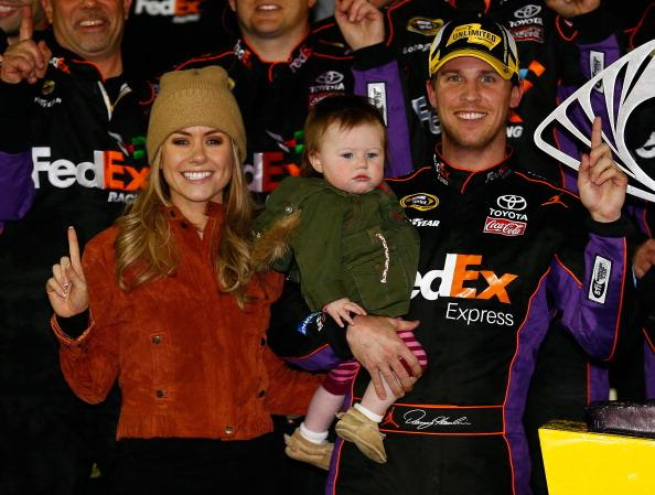 DAYTONA BEACH, FL - FEBRUARY 15:  (Right) Denny Hamlin, driver of the #11 FedEx Express Toyota, celebrates in victory lane with (left) Jordan Fish and daughter (center) Taylor during the NASCAR Sprint Cup Series Sprint Unlimited at Daytona International Speedway on February 15, 2014 in Daytona Beach, Florida.  (Photo by Tom Pennington/Getty Images)