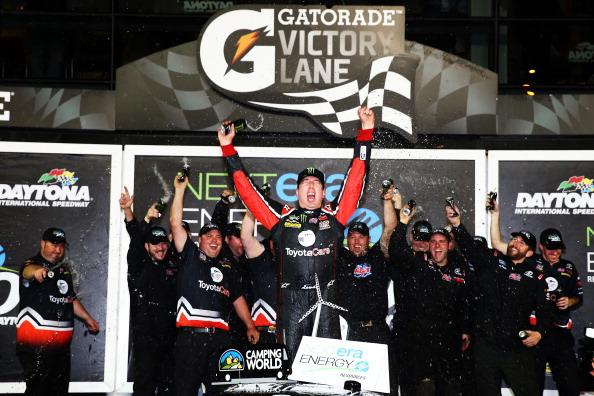 DAYTONA BEACH, FL - FEBRUARY 21:  Kyle Busch, driver of the #51 ToyotaCare Toyota, celebrates in Victory Lane after winning during the Camping World Truck Series NextEra Energy Resources 250 at Daytona International Speedway on February 21, 2014 in Daytona Beach, Florida.  (Photo by Tom Pennington/Getty Images)