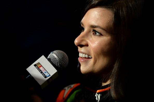 DAYTONA BEACH, FL - FEBRUARY 13:  NASCAR Sprint Cup Series driver Danica Patrick speaks to the media during the 2014 NASCAR Media Day at Daytona International Speedway on February 13, 2014 in Daytona Beach, Florida.  (Photo by Robert Laberge/Getty Images)