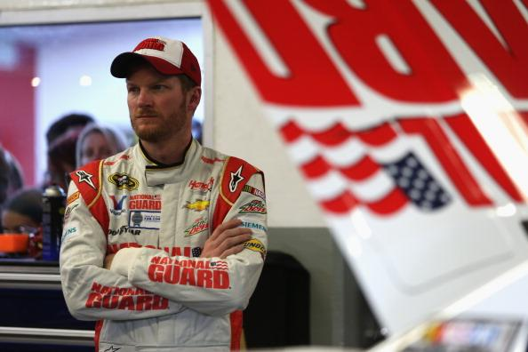 DAYTONA BEACH, FL - FEBRUARY 14:  Dale Earnhardt Jr., driver of the #88 National Guard Chevrolet, stands by his car during practice for the NASCAR Sprint Cup Series Sprint Unlimited at Daytona International Speedway on February 14, 2014 in Daytona Beach, Florida.  (Photo by Todd Warshaw/Getty Images)