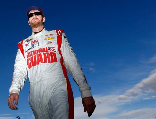 AVONDALE, AZ - FEBRUARY 28:  Dale Earnhardt Jr., driver of the #88 National Guard Chevrolet, walks on pit road prior to qualifying for the NASCAR Sprint Cup Series The Profit on CNBC 500 at Phoenix International Raceway on February 28, 2014 in Avondale, Arizona.  (Photo by Jonathan Ferrey/Getty Images)