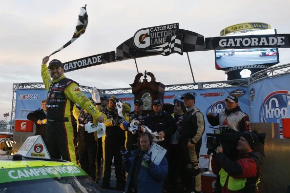 MARTINSVILLE, VA - MARCH 30:  Matt Crafton, driver of the #88 Ideal Doors / Menards Toyota, celebrates in victory lane after winning the NASCAR Camping World Truck Series Kroger 250 at Martinsville Speedway on March 30, 2014 in Martinsville, Virginia.  (Photo by Jeff Zelevansky/Getty Images)