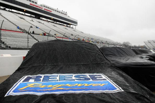 MARTINSVILLE, VA - MARCH 29:  Trucks sit covered from the rain on pit road during a rain delay in the NASCAR Camping World Truck Series Kroger 250 at Martinsville Speedway on March 29, 2014 in Martinsville, Virginia.  (Photo by Jeff Curry/Getty Images)