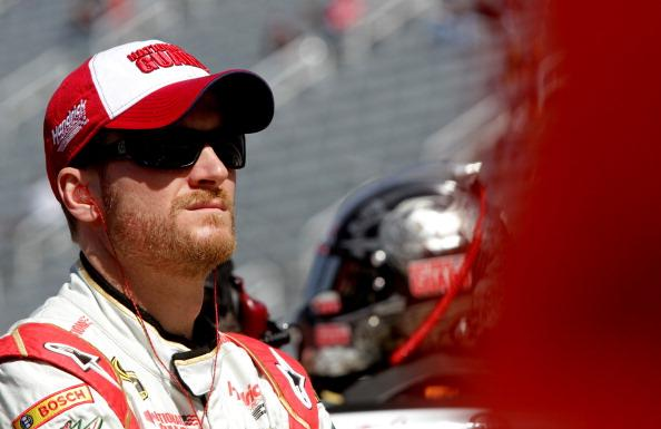 BRISTOL, TN - MARCH 14:  Dale Earnhardt Jr., driver of the #88 National Guard Chevrolet, stands in the garage area during practice for the NASCAR Sprint Cup Series Food City 500 at Bristol Motor Speedway on March 14, 2014 in Bristol, Tennessee.  (Photo by Jerry Markland/Getty Images)