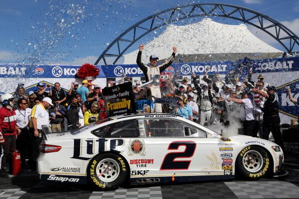 LAS VEGAS, NV - MARCH 09:  Brad Keselowski, driver of the #2 Miller Lite Ford, celebrates in Victory Lane after winning the NASCAR Sprint Cup Series Kobalt 400 at Las Vegas Motor Speedway on March 9, 2014 in Las Vegas, Nevada.  (Photo by Jerry Markland/Getty Images)