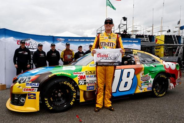 MARTINSVILLE, VA - MARCH 28:  Kyle Busch, driver of the #18 M&M's Toyota, poses with the Coors Light Pole Award after qualifying for the pole during qualifying for the NASCAR Sprint Cup Series STP 500 at Martinsville Speedway on March 28, 2014 in Martinsville, Virginia.  (Photo by Jeff Zelevansky/Getty Images)