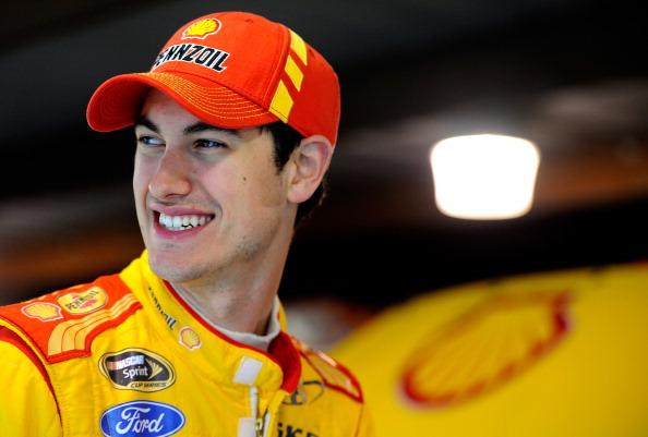 MARTINSVILLE, VA - MARCH 29:  Joey Logano, driver of the #22 Shell-Pennzoil Ford, looks on in the garage area during a rain delay in practice for the NASCAR Sprint Cup Series STP 500 at Martinsville Speedway on March 29, 2014 in Martinsville, Virginia.  (Photo by Jared C. Tilton/Getty Images)