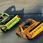 MARTINSVILLE, VA - MARCH 30:  Matt Crafton, driver of the #88 Ideal Doors / Menards Toyota, leads John Wes Townley, driver of the #5 Zaxby's Real Chicken Toyota, during the NASCAR Camping World Truck Series Kroger 250 at Martinsville Speedway on March 30, 2014 in Martinsville, Virginia.  (Photo by Jeff Curry/Getty Images)
