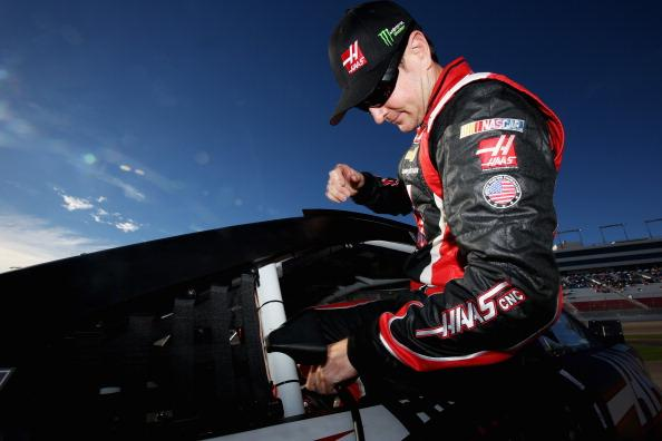 LAS VEGAS, NV - MARCH 07:  Kurt Busch, driver of the #41 Haas Automation Chevrolet, climbs into his car during qualifying for the NASCAR Sprint Cup Series Kobalt 400 at Las Vegas Motor Speedway on March 7, 2014 in Las Vegas, Nevada.  (Photo by Nick Laham/Getty Images)