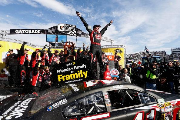 MARTINSVILLE, VA - MARCH 30:  Kurt Busch, driver of the #41 Haas Automation Chevrolet, celebrates in Victory Lane after winning the NASCAR Sprint Cup Series STP 500 at Martinsville Speedway on March 30, 2014 in Martinsville, Virginia.  (Photo by Jeff Zelevansky/Getty Images)
