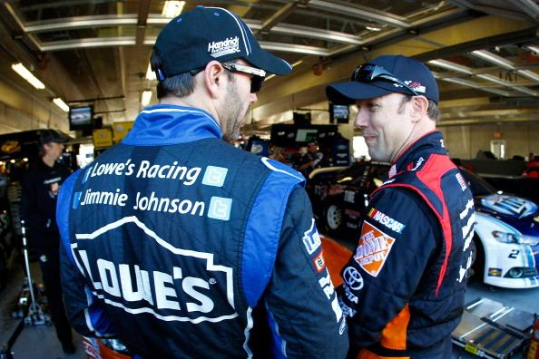 "FORT WORTH, TX - NOVEMBER 01 2013:  (L-R) Jimmie Johnson, driver of the #48 Lowe's Chevrolet, and Matt Kenseth, driver of the #20 Home Depot ""Let's Do This"" Toyota, talk in the garage area during practice for the NASCAR Sprint Cup Series AAA Texas 500 at Texas Motor Speedway on November 1, 2013 in Fort Worth, Texas.  (Photo by Jeff Zelevansky/Getty Images for Texas Motor Speedway)"