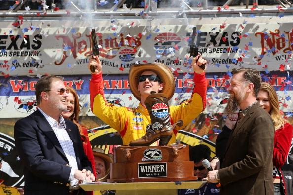 FORT WORTH, TX - APRIL 07:  Joey Logano, driver of the #22 Shell-Pennzoil/Hertz Ford, celebrates in Victory Lane with Texas Motor Speedway President Eddie Gossage (L) during the NASCAR Nationwide Series O'Reilly Auto Parts 300 at Texas Motor Speedway on April 4, 2014 in Fort Worth, Texas.  (Photo by Jerry Markland/Getty Images for Texas Motor Speedway)