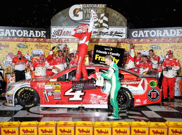 DARLINGTON, SC - APRIL 12:  Kevin Harvick, driver of the #4 Budweiser Chevrolet, celebrates in Victory Lane after winning the NASCAR Sprint Cup Series Bojangles' Southern 500 at Darlington Raceway on April 12, 2014 in Darlington, South Carolina.  (Photo by Jerry Markland/Getty Images)