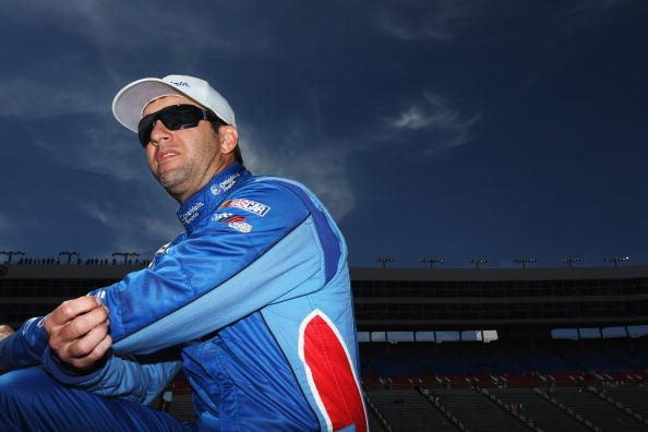 FORT WORTH, TX - APRIL 04:  Elliott Sadler, driver of the #11 OneMain Financial Toyota, stands on the grid during qualifying for the NASCAR Nationwide Series O'Reilly Auto Parts 300 at Texas Motor Speedway on April 4, 2014 in Fort Worth, Texas.  (Photo by Nick Laham/Getty Images for Texas Motor Speedway)