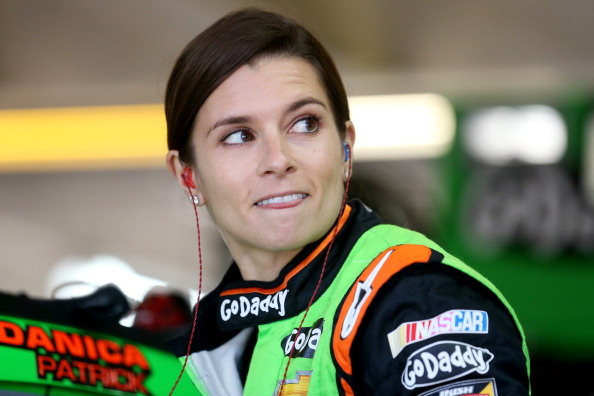 CHARLOTTE, NC - MAY 16:  Danica Patrick, driver of the #10 GoDaddy Cares Chevrolet, stands in the garage areaduring practice for the NASCAR Sprint Cup Series Sprint Showdown at Charlotte Motor Speedway on May 16, 2014 in Charlotte, North Carolina.  (Photo by Nick Laham/Getty Images)