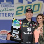 CHARLOTTE, NC - MAY 16: Kyle Busch, driver of the #51 Hiring Our Heroes/Toyota Care Toyota, poses with his wife, Samantha Busch, in victory lane after winning the NASCAR Camping World Truck Series North Carolina Education Lottery 200 at Charlotte Motor Speedway on May 16, 2014 in Charlotte, North Carolina.  (Photo by Jerry Markland/Getty Images)