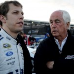 CHARLOTTE, NC - MAY 17:  Brad Keselowski (L), driver of the #2 Miller Lite Ford, talks to his team owner, Roger Penske, during qualifying for the NASCAR Sprint Cup Series Sprint All-Star Race at Charlotte Motor Speedway on May 17, 2014 in Charlotte, North Carolina.  (Photo by Rainier Ehrhardt/Getty Images)