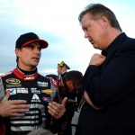 CHARLOTTE, NC - MAY 17: Jeff Gordon (L), driver of the #24 Drive To End Hunger Chevrolet, talks to Brian France, CEO of NASCAR, during qualifying for the NASCAR Sprint Cup Series Sprint All-Star Race at Charlotte Motor Speedway on May 17, 2014 in Charlotte, North Carolina.  (Photo by Rainier Ehrhardt/Getty Images)