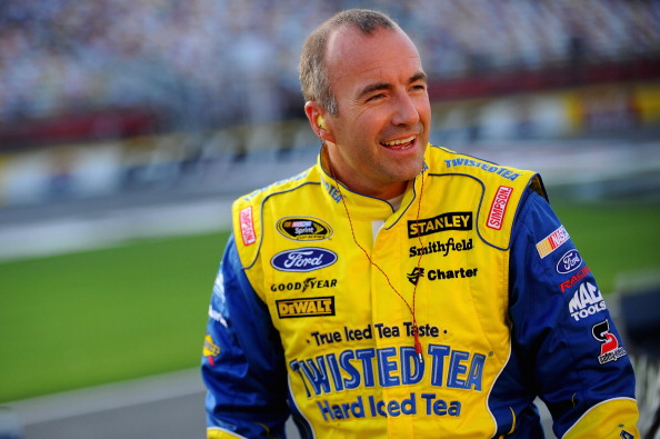 CHARLOTTE, NC - MAY 22:  Marcos Ambrose, driver of the #9 Twisted Tea Ford, stands on the grid during qualifying for the NASCAR Sprint Cup Series Coca-Cola 600 at Charlotte Motor Speedway on May 22, 2014 in Charlotte, North Carolina.  (Photo by Will Schneekloth/Getty Images)