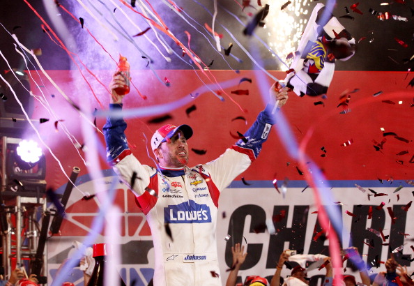 CHARLOTTE, NC - MAY 25:  Jimmie Johnson, driver of the #48 Lowe's Patriotic Chevrolet, celebrates in victory lane after winning the NASCAR Sprint Cup Series Coca-Cola 600 at Charlotte Motor Speedway on May 25, 2014 in Charlotte, North Carolina.  (Photo by Sarah Glenn/Getty Images)