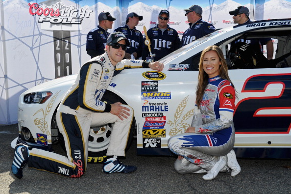 DOVER, DE - MAY 30:  Brad Keselowski, driver of the #2 Miller Lite Ford, and Miss Coors Light Rachel Rupert pose with the Coors Light Pole Award after qualifying for the pole for the NASCAR Sprint Cup Series FedEx 400 Benefiting Autism Speaks at Dover International Speedway on May 30, 2014 in Dover, Delaware.  (Photo by Patrick Smith/Getty Images)