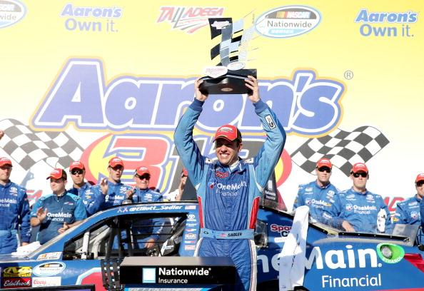 TALLADEGA, AL - MAY 03:  Elliott Sadler, driver of the #11 OneMain Financial Toyota, celebrates in Victory Lane with the trophy after winning the NASCAR Nationwide Series Aaron's 312 at Talladega Superspeedway on May 3, 2014 in Talladega, Alabama.  (Photo by Sean Gardner/Getty Images)