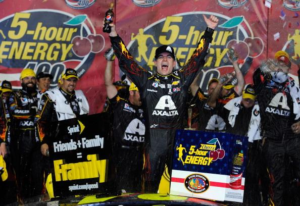 KANSAS CITY, KS - MAY 10:  Jeff Gordon, driver of the #24 Axalta Coatings Chevrolet, celebrates in victory lane after winning the NASCAR Sprint Cup Series 5-Hour Energy 400 at Kansas Speedway on May 10, 2014 in Kansas City, Kansas.  (Photo by Jared C. Tilton/Getty Images)