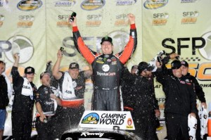 KANSAS CITY, KS - MAY 09: Kyle Busch, driver of the #51 ToyotaCare Toyota, celebrates in victory lane after winning the NASCAR Camping World Truck Series SFP 250 at Kansas Speedway on May 9, 2014 in Kansas City, Kansas.  (Photo by Jared C. Tilton/Getty Images)