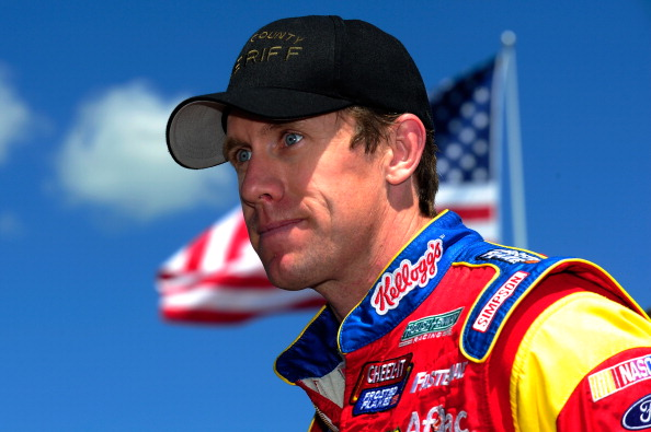 LONG POND, PA - JUNE 07:  Carl Edwards, driver of the #99 Kelloggs/Cheez-It Ford, stands in the garage area during practice for the NASCAR Sprint Cup Series Pocono 400 at Pocono Raceway on June 7, 2014 in Long Pond, Pennsylvania.  (Photo by Jeff Curry/Getty Images)