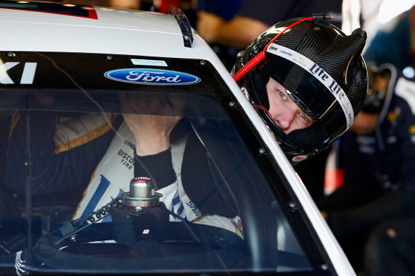 BROOKLYN, MI - JUNE 14:  Brad Keselowski, driver of the #2 Miller Lite Ford, climbs into his car in the garage area during practice for the NASCAR Sprint Cup Series Quicken Loans 400 at Michigan International Speedway on June 14, 2014 in Brooklyn, Michigan.  (Photo by Gregory Shamus/Getty Images)
