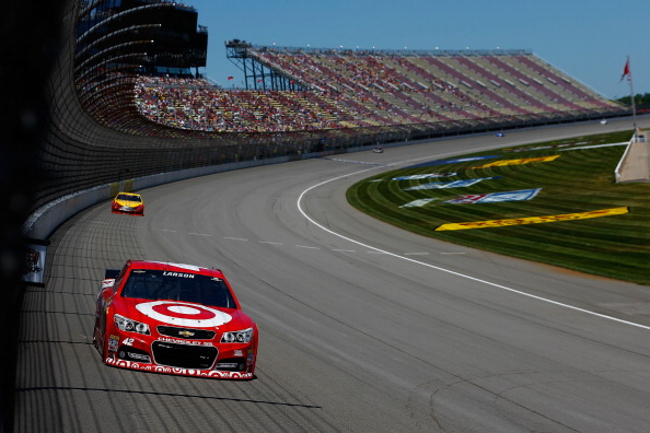 BROOKLYN, MI - JUNE 14:  Kyle Larson, driver of the #42 Target Chevrolet, leads Joey Logano, driver of the #22 Shell Pennzoil Ford, during practice for the NASCAR Sprint Cup Series Quicken Loans 400 at Michigan International Speedway on June 14, 2014 in Brooklyn, Michigan.  (Photo by Chris Trotman/Getty Images)