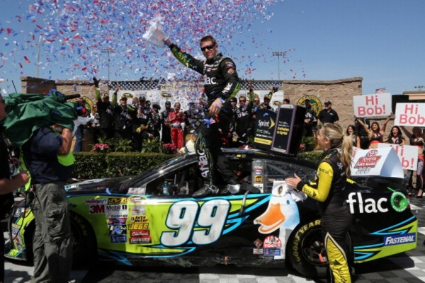 SONOMA, CA - JUNE 22:  Carl Edwards, driver of the #99 Aflac Ford, celebrates i Victory Lane after winning the NASCAR Sprint Cup Series Toyota/Save Mart 350 at Sonoma Raceway on June 22, 2014 in Sonoma, California.  (Photo by Jerry Markland/Getty Images)