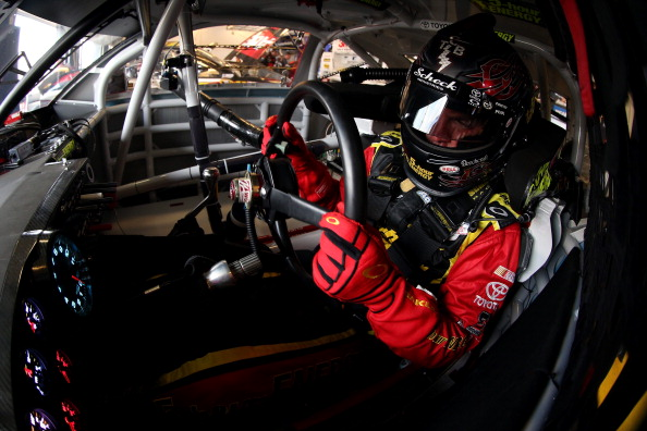 SPARTA, KY - JUNE 27:  Clint Bowyer, driver of the #15 5-hour ENERGY Toyota, sits in his car during practice for the NASCAR Sprint Cup Series Quaker State 400 presented by Advance Auto Parts at Kentucky Speedway on June 27, 2014 in Sparta, Kentucky.  (Photo by Todd Warshaw/Getty Images)