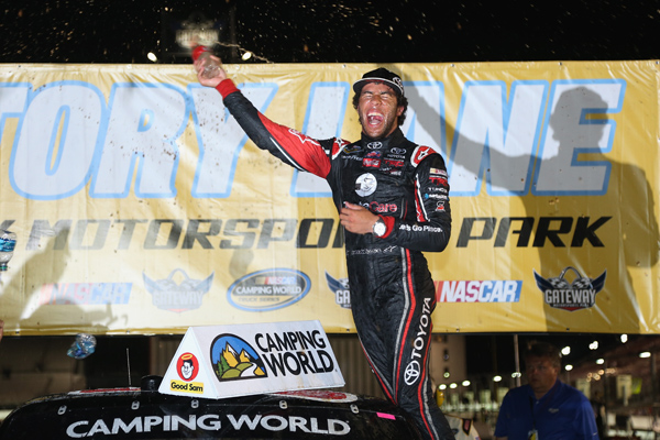 MADISON, IL - JUNE 14:  Darrell Wallace Jr., driver of the Toyota Toyota, celebrates in victory lane after winning the NASCAR Camping World Truck Series Drivin' For Linemen 200 at Gateway Motorsports Park on June 14, 2014 in Madison, Illinois.  (Photo by Todd Warshaw/NASCAR via Getty Images)