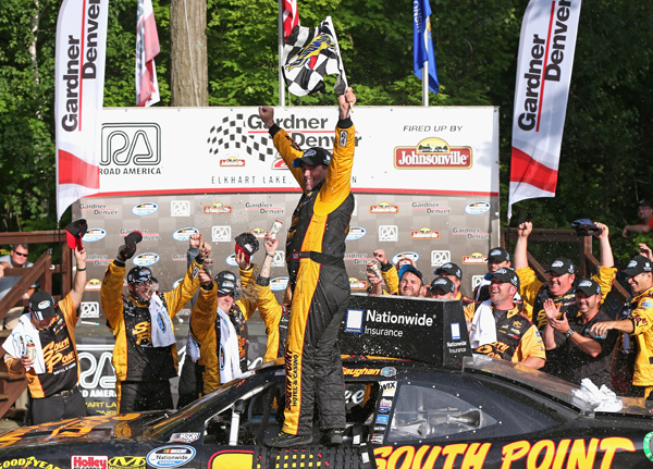 ELKHART LAKE, WI - JUNE 21:  Brendan Gaughn, driver of the #62 South Point Chevrolet, celebrates winning the Gardner Denver 200 Fired Up by Johnsonville race at Road America on June 21, 2014 in Elkhart Lake, Wisconsin.  (Photo by Jonathan Daniel/Getty Images)
