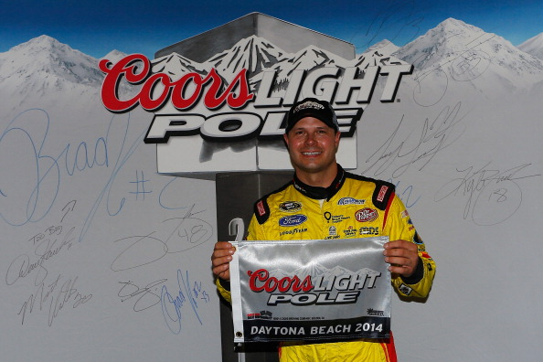 DAYTONA BEACH, FL - JULY 04:  David Gilliland, driver of the #38 Love's Travel Stops Ford, celebrates winning the pole position after qualifying for the NASCAR Sprint Cup Series Coke Zero 400 at Daytona International Speedway on July 4, 2014 in Daytona Beach, Florida.  (Photo by Chris Trotman/Getty Images)