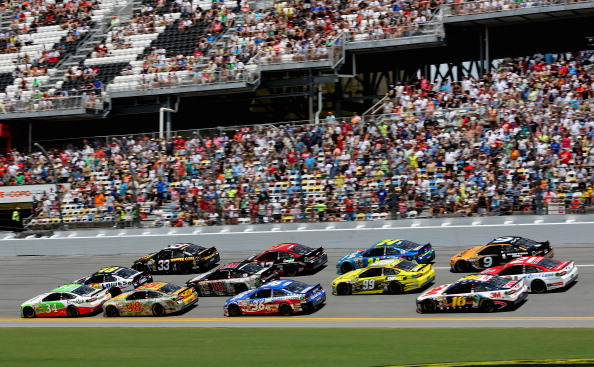 DAYTONA BEACH, FL - JULY 06: David Ragan, driver of the #34 Farm Rich Ford, leads a pack of cars during the NASCAR Sprint Cup Series Coke Zero 400 at Daytona International Speedway on July 6, 2014 in Daytona Beach, Florida.  (Photo by Jerry Markland/Getty Images)