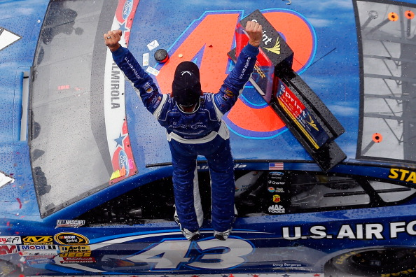 DAYTONA BEACH, FL - JULY 06:  Aric Almirola, driver of the #43 United States Air Force Ford, celebrates in Victory Lane after winning the NASCAR Sprint Cup Series Coke Zero 400 after the race was called for weather at Daytona International Speedway on July 6, 2014 in Daytona Beach, Florida.  (Photo by Chris Trotman/Getty Images)