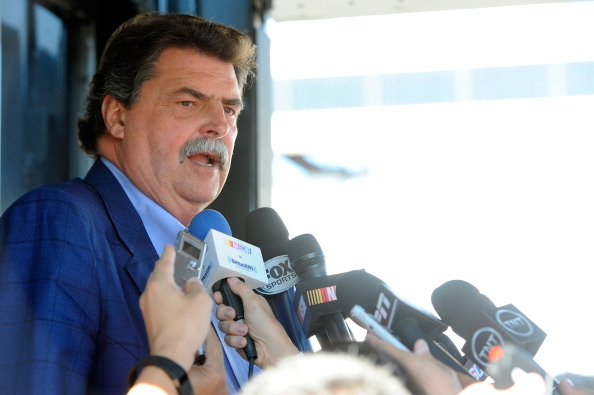 LOUDON, NH - JULY 11:  NASCAR President Mike Helton speaks with the media in the garage area prior to practice for the NASCAR Sprint Cup Series Camping World RV Sales 301 at New Hampshire Motor Speedway on July 11, 2014 in Loudon, New Hampshire.  (Photo by Jared C. Tilton/Getty Images)