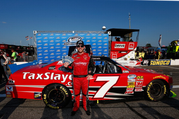 LOUDON, NH - JULY 12:  Regan Smith, driver of the #7 TaxSlayer.com Chevrolet, celebrates winning the Nationwide Dash4Cash during the NASCAR Nationwide Series Sta-Green 200 at New Hampshire Motor Speedway on July 12, 2014 in Loudon, New Hampshire.  (Photo by Chris Trotman/Getty Images)