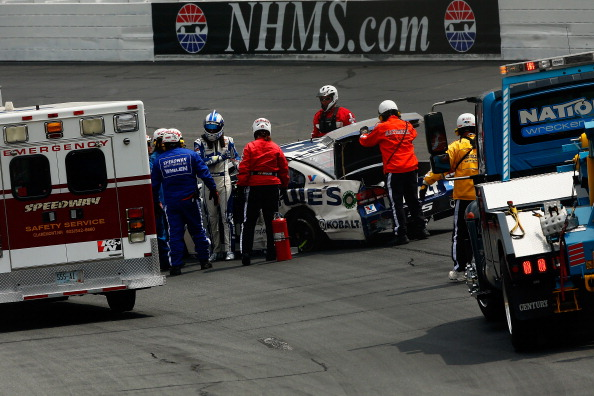 LOUDON, NH - JULY 13:  Jimmie Johnson, driver of the #48 Lowe's Chevrolet, walks from his car after crashing during the NASCAR Sprint Cup Series Camping World RV Sales 301 at New Hampshire Motor Speedway on July 13, 2014 in Loudon, New Hampshire.  (Photo by Jared Wickerham/Getty Images)