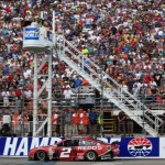 LOUDON, NH - JULY 13:  Brad Keselowski, driver of the #2 Redds Ford, comes to the finish line to win the NASCAR Sprint Cup Series Camping World RV Sales 301 at New Hampshire Motor Speedway on July 13, 2014 in Loudon, New Hampshire.  (Photo by Nick Laham/Getty Images)
