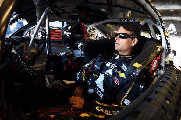 INDIANAPOLIS, IN - JULY 25:  Jeff Gordon, driver of the #24 Axalta Chevrolet, sits in his car in the garage area during practice for the NASCAR Sprint Cup Series Crown Royal Presents The John Wayne Walding 400 at Indianapolis Motor Speedway on July 25, 2014 in Indianapolis, Indiana.  (Photo by Rainier Ehrhardt/Getty Images)