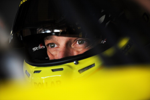 INDIANAPOLIS, IN - JULY 25:  Matt Kenseth, driver of the #20 Dollar General Toyota, sits in his car in the garage area during practice for the NASCAR Sprint Cup Series Crown Royal Presents The John Wayne Walding 400 at Indianapolis Motor Speedway on July 25, 2014 in Indianapolis, Indiana.  (Photo by Rainier Ehrhardt/Getty Images)