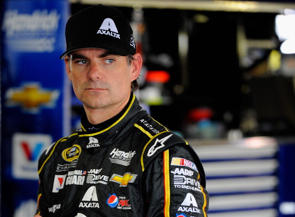 LONG POND, PA - AUGUST 02:  Jeff Gordon, driver of the #24 Axalta Chevrolet, looks on from in the garage during practice for the NASCAR Sprint Cup Series GoBowling.com 400 at Pocono Raceway on August 2, 2014 in Long Pond, Pennsylvania.  (Photo by Jared C. Tilton/Getty Images)