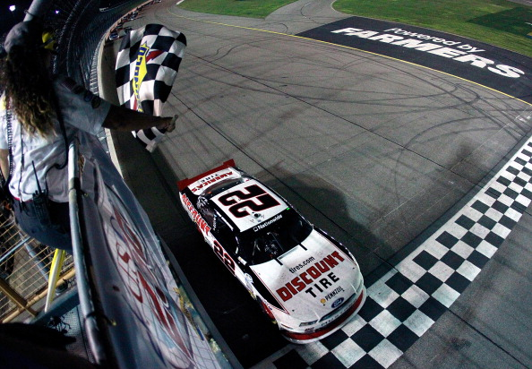 NEWTON, IA - AUGUST 02:  Brad Keselowski, driver of the #22 Discount Tire Ford, wins the Nationwide Series U.S. Cellular 250 at Iowa Speedway on August 2, 2014 in Newton, Iowa.  (Photo by Brian Lawdermilk/Getty Images)