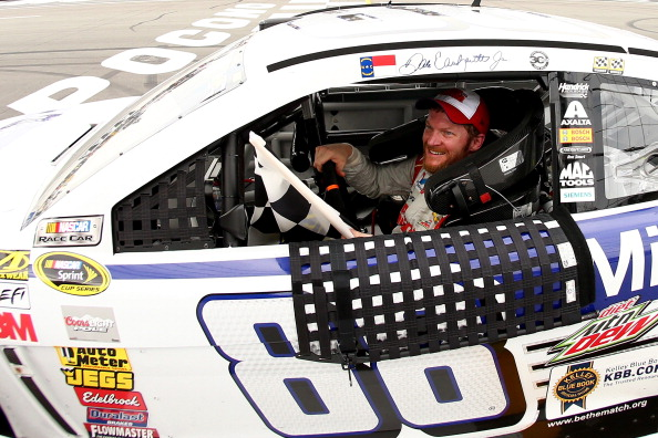 LONG POND, PA - AUGUST 03:  Dale Earnhardt Jr., driver of the #88 Michael Baker International Chevrolet, celebrates after winning the NASCAR Sprint Cup Series GoBowling.com 400 at Pocono Raceway on August 3, 2014 in Long Pond, Pennsylvania.  (Photo by Elsa/Getty Images)