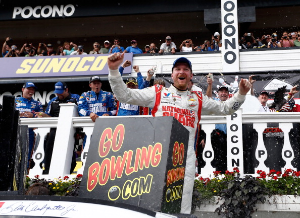 LONG POND, PA - AUGUST 03:  Dale Earnhardt Jr., driver of the #88 Michael Baker International Chevrolet, celebrates in Victory Lane after winning the NASCAR Sprint Cup Series GoBowling.com 400 at Pocono Raceway on August 3, 2014 in Long Pond, Pennsylvania.  (Photo by Jeff Zelevansky/Getty Images)